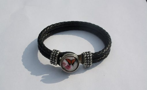 Armband met vlinder drukknoop zwart